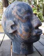 Mozambique Man - A marble sculpture by Cliff Fraser